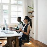 A young woman learning digital marketing at her desk